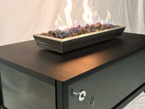A top quality, modern style, heavy duty steel rectangular shaped IMPACT propane or natural gas burning Fire Table or fire pit for entertaining or relaxing outdoors on your patio, rooftop deck or in your garden.  Made in America USA.