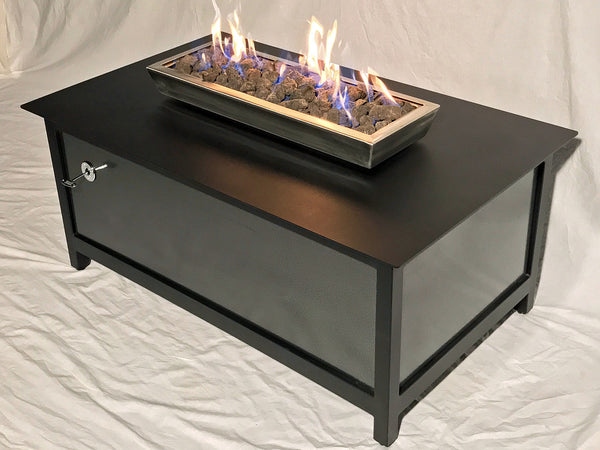 A high quality, modern style, heavy duty steel rectangular shaped IMPACT propane or natural gas burning Fire Table or fire pit for entertaining or relaxing outdoors on your patio, rooftop deck or in your garden.  Made in America USA.