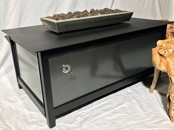 A best quality, modern style, heavy duty steel rectangular shaped IMPACT propane or natural gas burning Fire Table or fire pit for entertaining or relaxing outdoors on your patio, rooftop deck or in your garden.  Made in America USA.