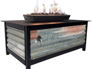An edgy, urban, contemporary, modern industrial rustic farmhouse style, heavy duty steel rectangular shaped IMPACT propane or natural gas burning Fire Table or fire pit with salvaged corrugated steel exterior side panels and a raven black powder coated frame and table top for entertaining or relaxing outdoors on your patio, rooftop deck or in your garden.  Made in America USA.