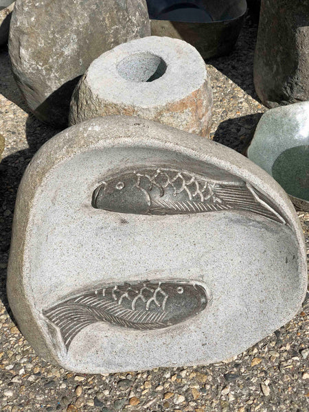 River boulder rock bird bath with Koi Fish motif.  Bowl is hand cut from a single piece of natural stone.