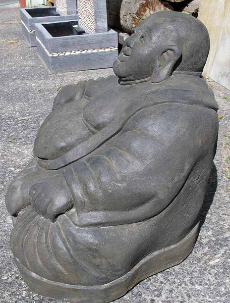 A large seated fat happy Buddha stone statue for indoor or outdoor use.