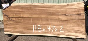 A large Sustainably Harvested and Kiln Dried Natural live edge two inch thick monkeypod or parota or guanacaste wood slab for a sliding rolling barn door or kitchen island or table top from Impact Imports in Boise Idaho.
