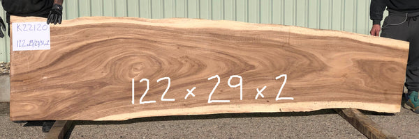 A large Sustainably Harvested and Kiln Dried Natural live edge two inch thick monkeypod or parota or guanacaste wood slab for a long commercial bar top, a restaurant community table or conference table top from Impact Imports in Boise Idaho.