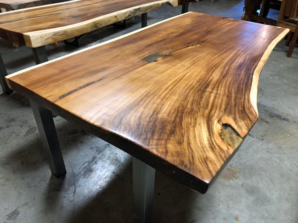 Extra large long canela cinnamon wood natural live edge sustainably harvested kiln dried wood slab dining or conference table or kitchen island top with a satin urethane finish.