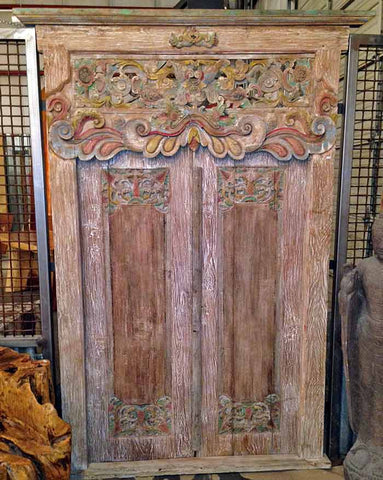 Salvaged Reclaimed Antique teak door and frame architectural element that was hand carved on Madura Island, Indonesia.