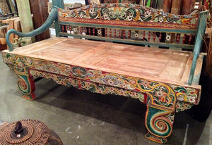 Original antique vintage highly carved and colorful teak wood daybed from Madura island, Indonesia.