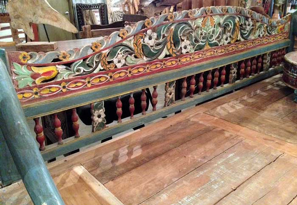 Detail picture of an original antique vintage highly carved and colorful teak wood daybed from Madura island, Indonesia.
