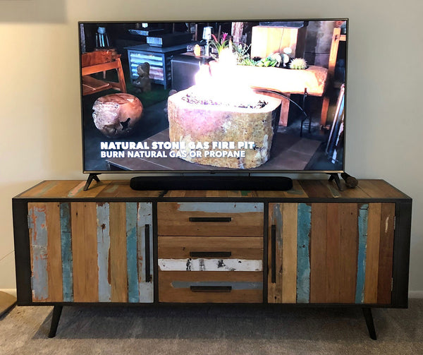 modern salvaged reclaimed boat wood cabinet TV console with a 65 inch TV on top