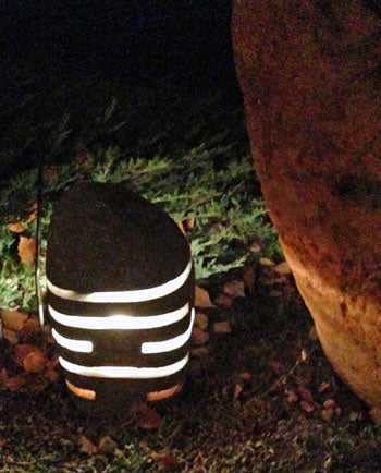 Garden lights cut from real river stone rock boulders.  Electrical by others.