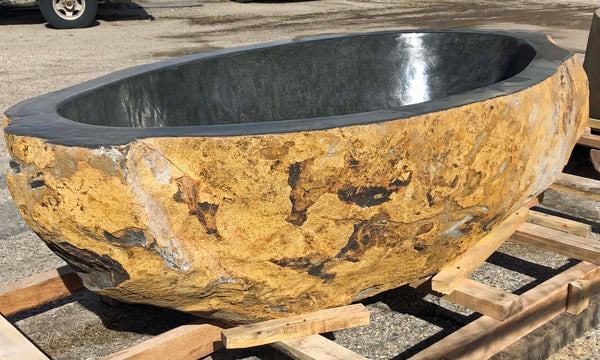 River Boulder real natural rock hot tub or Bathtub cut from a single piece of stone from Impact Imports in Boise Idaho.