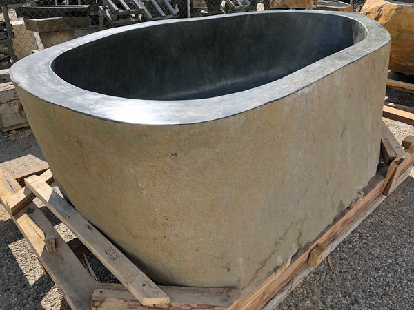 A Large River Boulder real natural rock hot tub or Bathtub cut from a single piece of stone from Impact Imports in Boise Idaho.