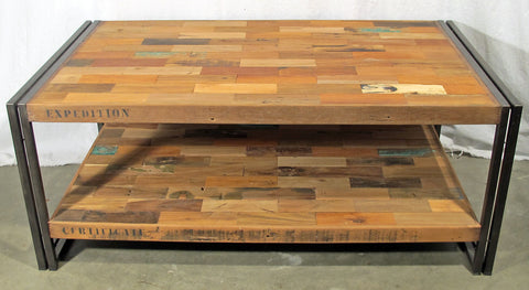 A rectangular coffee table with 2 shelves hand crafted from steel and salvaged reclaimed repurposed fishing boat wood.