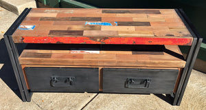 A TV television or gaming console with 3 drawers and 1 open shelf area hand crafted from steel and salvaged reclaimed repurposed fishing boat wood.