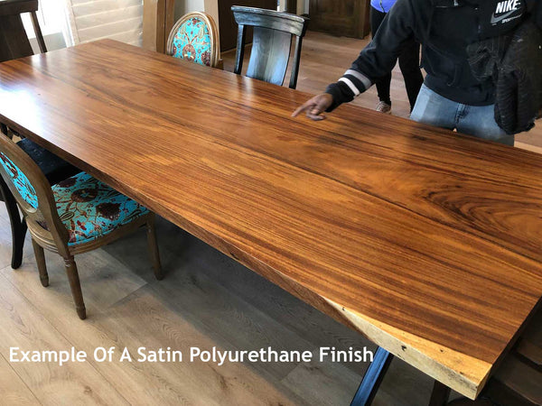 Picture of a natural live edge wood slab with a satin urethane finish at Impact Imports in Boise Idaho
