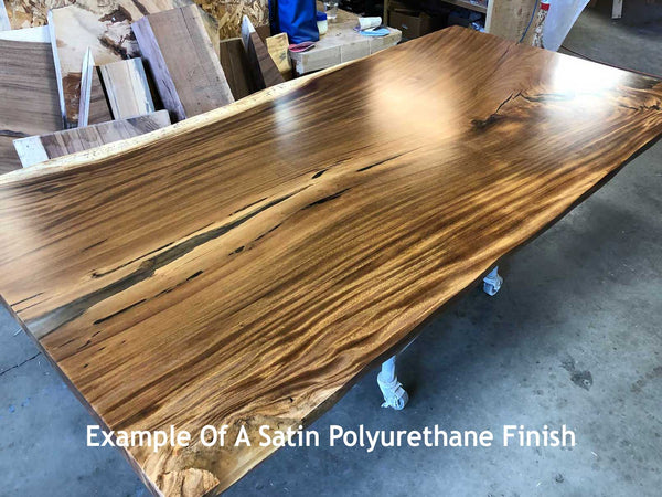Picture of a sustainably harvested kiln dried natural live edge wood slab table top with a satin urethane finish at Impact Imports in Boise Idaho