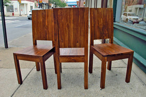 Solid sturdy reclaimed teak solid back dining chairs with a slightly rustic or textured surface for indoor or outdoor use.