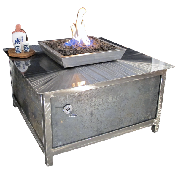A modern industrial style, heavy duty hand brushed stainless steel square shaped IMPACT propane or natural gas burning Fire Table or fire pit with salvaged raw steel exterior side panels for entertaining or relaxing outdoors on your patio, rooftop deck or in your garden.  Made in the USA America