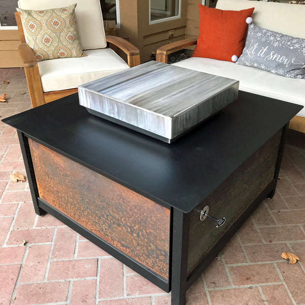 A hand brushed 304 stainless steel square shape firebox cover for a modern industrial style heavy duty steel or stainless steel IMPACT fire table to increase the overall usable table space when the fire is not burning.  Made in the USA America.
