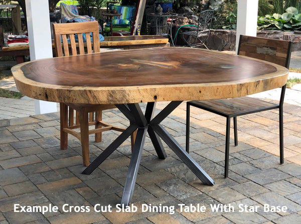 Example of a large cross cut or cookie shaped or round natural or live edge wood slab on a custom heavy duty star style base from impact imports.