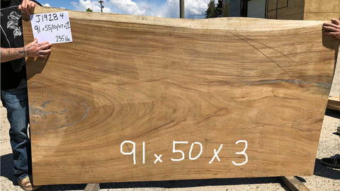 Sustainably Harvested Kiln Dried Natural live edge monkeypod or parota extra large wide jumbo wood slab kitchen island or conference table top from Impact Imports in Boise Idaho.
