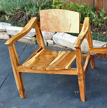 A mid century modern scandinavian style chair made from reclaimed teak wood that can be used inside or outdoors as patio furniture.
