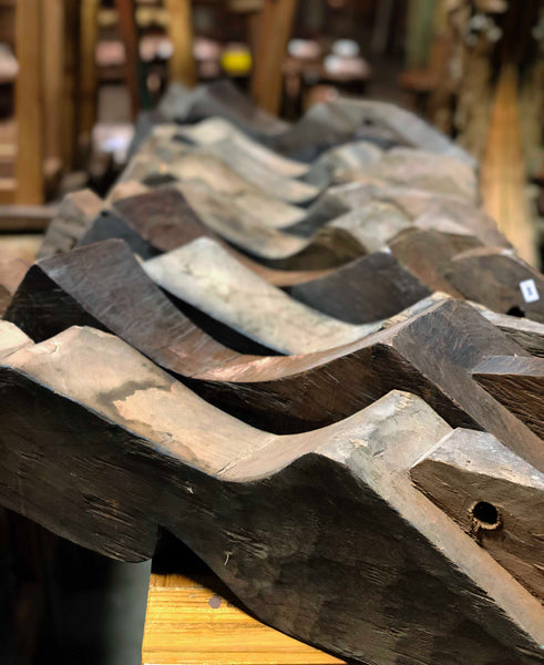 Salvaged reclaimed hand cut carved teak knee braces from Indonesia.
