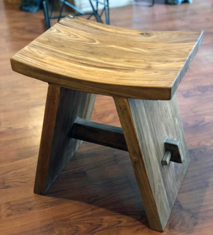 A comfortable, heavy and sturdy reclaimed teak zen stool with a smooth rustic texture that can be indoors or outdoors or as a stool for your shower!