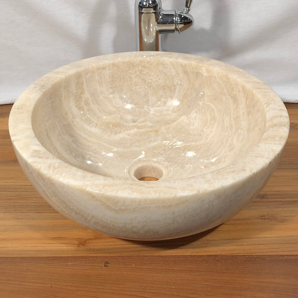 Beautifully subtle white marble and honey onyx round natural stone vessel sink fully polished.