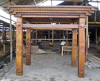 Traditional Joglo Indonesian Java house frame and ceiling beams highly carved from teak.