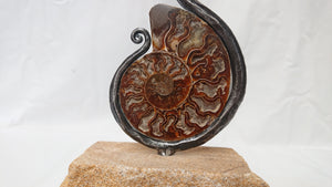 """Creation Snake"", ammonite and iron sculpture"