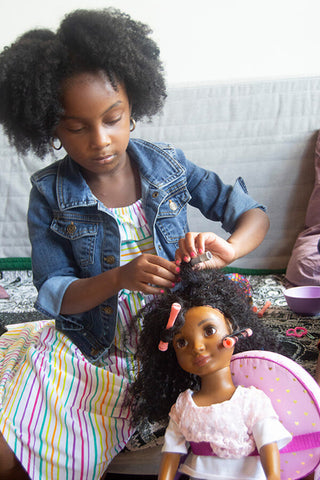 African American Girl playing with doll with naturally curly hair from Healthy Roots Dolls