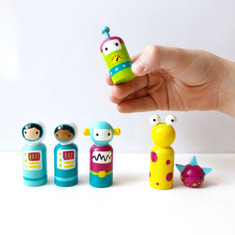 Space themed peg dolls