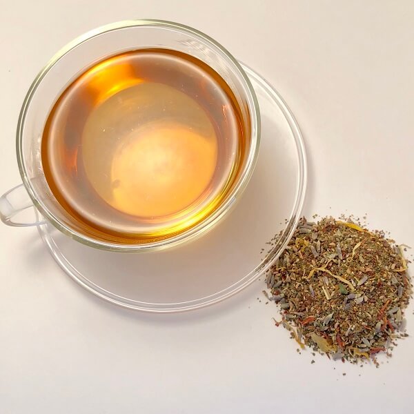 loose leaf ayurvedic tea containing rooibos nettle rosehip lavender and cornflower petals