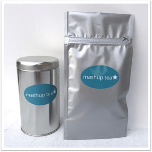 tall silver tin tea caddy and foil pouch with mashup tea branding