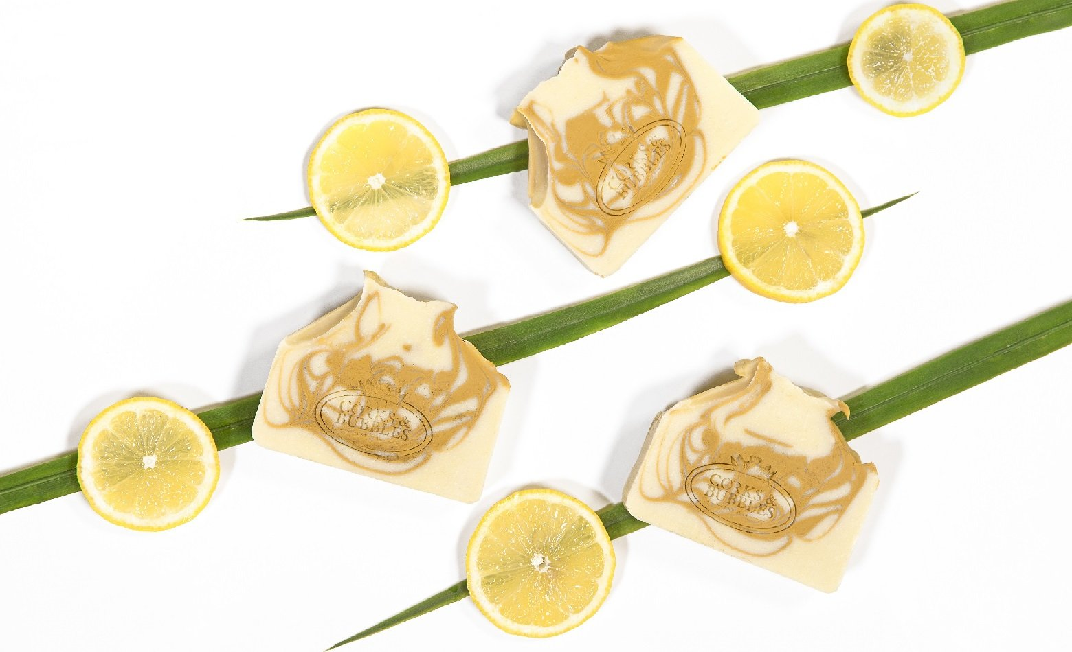 product picture lemongrass soap with slices of lemon and grass blades