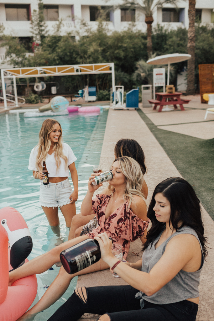Bride Hanging at the Pool | 5 Tips for Planning the Best Bachelorette Weekend | designtwentyfive
