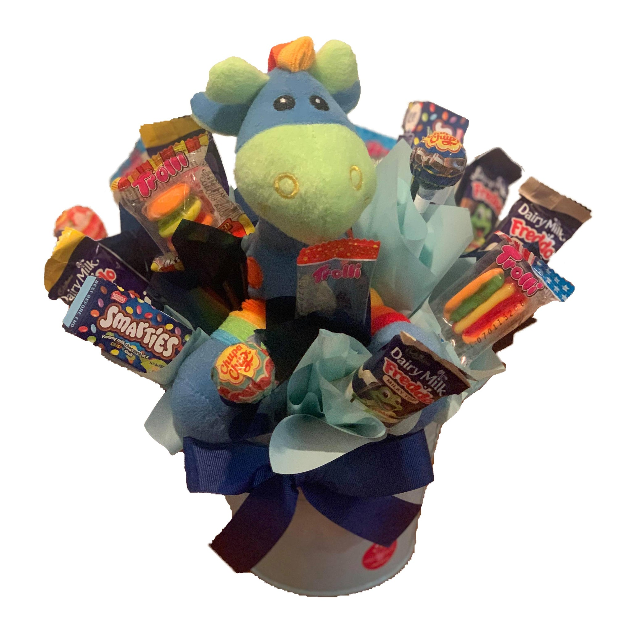 Blue Giraffe in a metal tin surrounded by chocolate and lollies