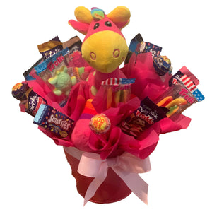 Pink Giraffe in a metal tin surrounded by chocolate and lollies