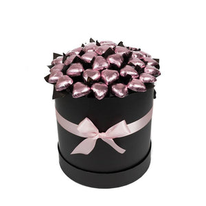 Pink foiled Belgian chocolate hearts presented in a black hat box with a pink ribbon