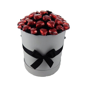 Red foiled Belgian milk chocolate hearts presented in a white hat box with black ribbon