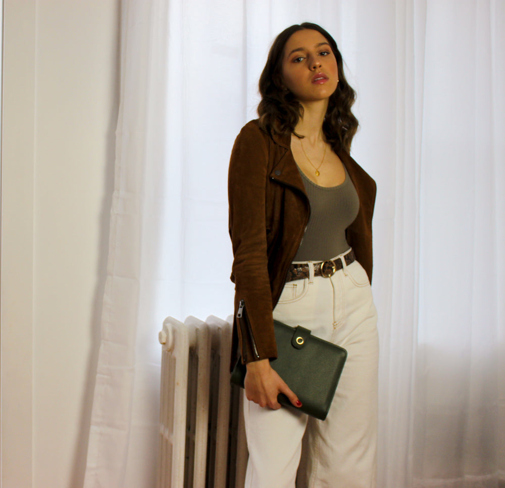 woman holding a5 green leather planner