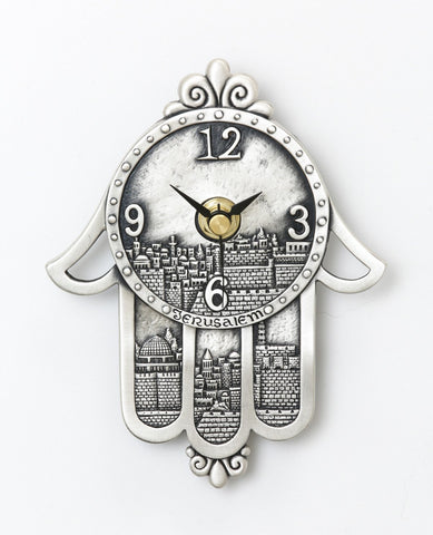 Sterling silver plated clock in the shape of hamsa.  Length: 15 cm  Width: 11 cm