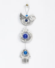 A graceful seven blessings hanging ornament coated in sterling silver, that brings joy and blesses. The ornament is made up from three motifs from the world of charms: a bird, a pomegranate and a Hamsa. All are connected to each other by a thin silver coated string decorated by blue beads, with a loop at the end for hanging. Each motif is designed with unique decorative embossments, and together create a charming and harmonic whole. Written on each one of the shapes are words of blessing, in Hebrew on one s