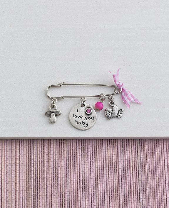 Baby Girl pin with cute elements, sterling silver plated.  Length: 4 cm  Width: 5 cm
