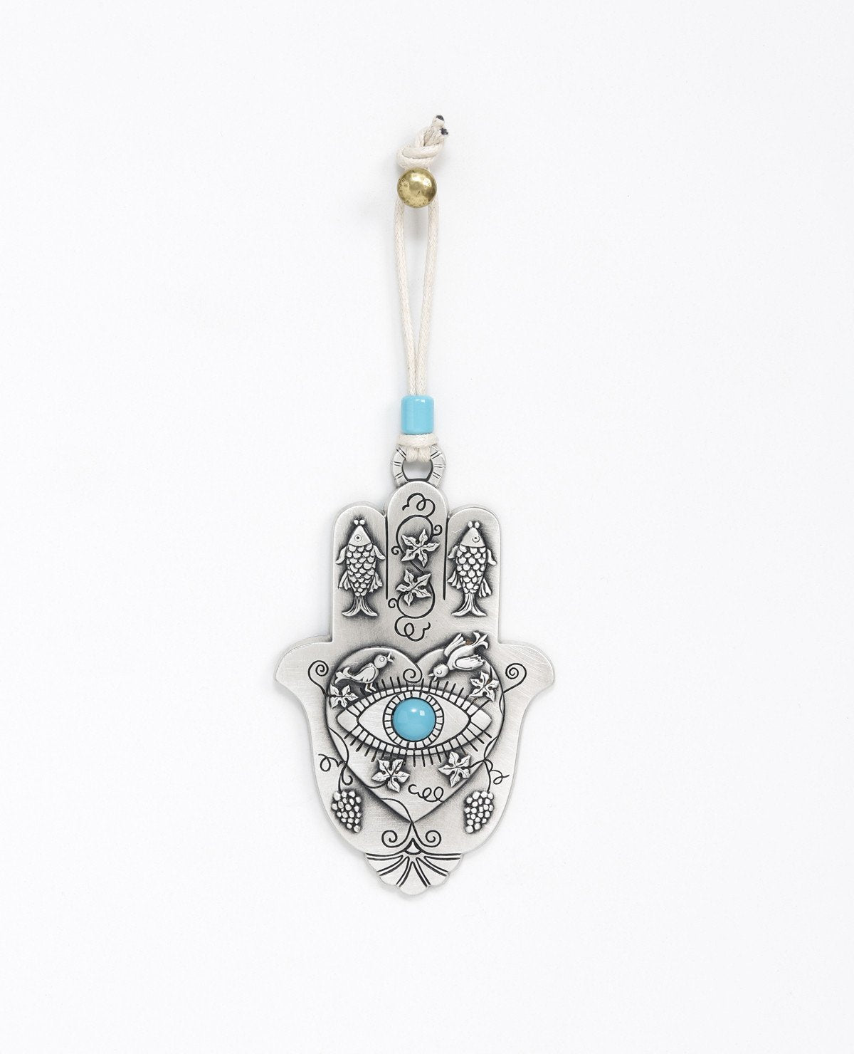 "A hanging Hamsa ornament packed with goodness! The Hamsa is coated in sterling silver and comes with a natural colored faux leather string for hanging, decorated by a turquoise bead. At the center of the Hamsa is a big heart with an embossed eye inside embedded with a turquoise colored stone (against the ""evil eye""). Above the eye are chirping birds (of peace and love). The Hamsa is decorated with embossed fish (for luck), as well as vine leaves and grape clusters (for abundance). What else could we ask for"