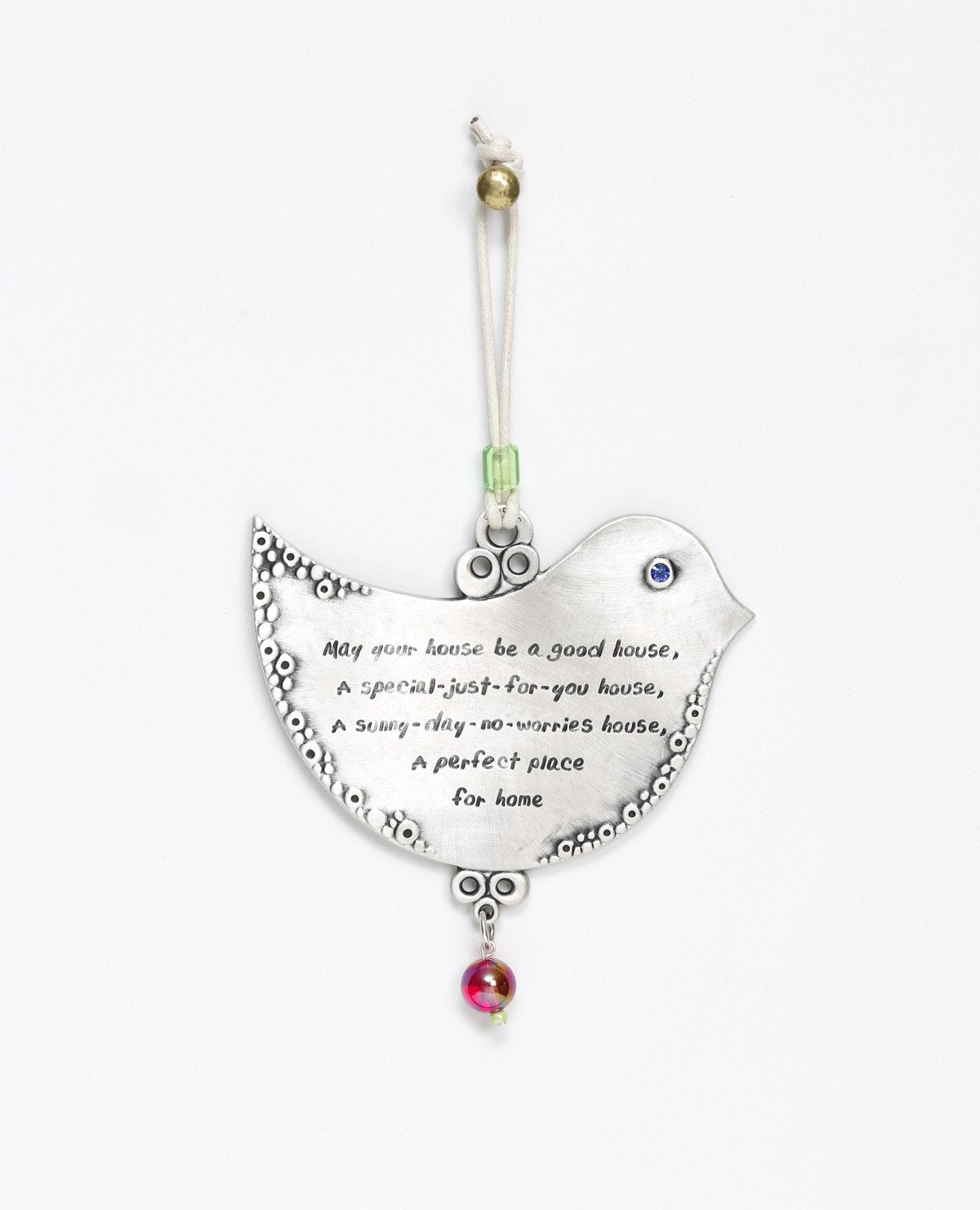 A hanging Home Blessing ornament shaped like a dove, with a special blessing for the home engraved on it in both Hebrew and English. The words are authentic and full of inspiration, calling for prosperity, love and wishes coming true. The ornament is coated in sterling silver, inlaid with a Swarovski crystal and comes with a faux leather string decorated with colorful beads. This original decorative piece makes an inspirational gift for the home, for new journeys and people that are loved.  Comes also in yo