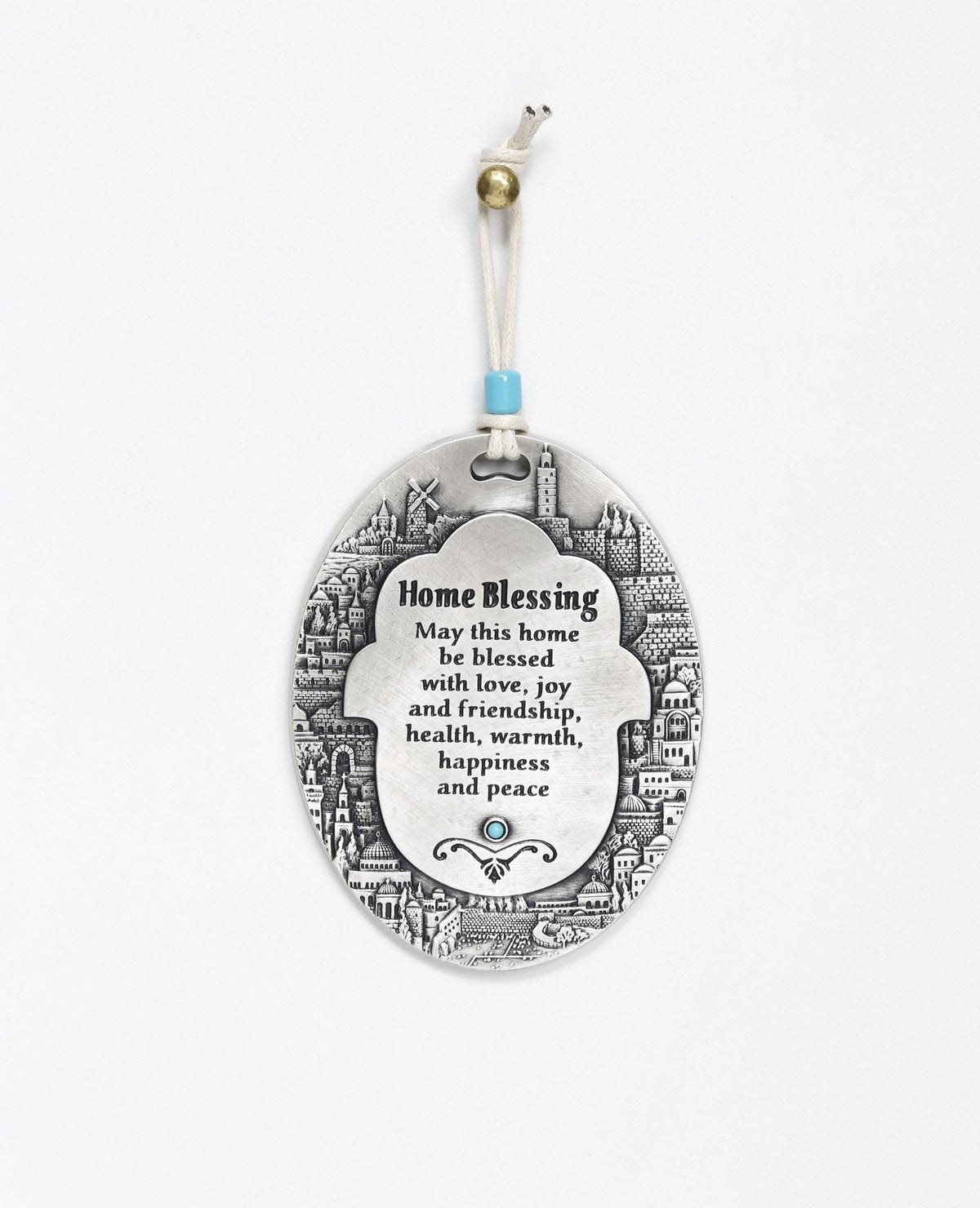 A spectacularly beautiful hanging Home Blessing ornament in English, in the shape of an oval plate. The plate is embedded around its edges with an outline of the sights of Jerusalem, and in the center a Hamsa upon which appear blessing words for love, friendship, joy, health, happiness and peace. Makes a very welcoming gift for the home intended for the people we hold dear, far or near. The hanging ornament is coated in sterling silver and embedded with a turquoise colored Swarovski crystal. Comes with a na