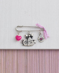 Baby Girl pin with cute elements, sterling silver plated.  Length: 5 cm  Width: 4 cm
