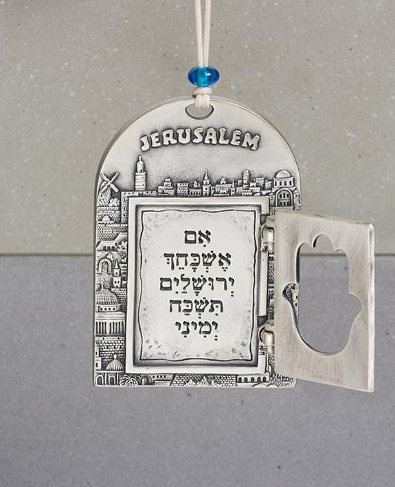 """If I forget you, Jerusalem, may my right hand forget its skill."" is a passage which is spoken in Jewish celebrations, when we wish to remind that along with our great joy, we will always remember the destruction of the Temple. This passage compares Jerusalem to one of our limbs, to emphasize the importance and sanctity of Jerusalem for us, as if it were a part of the body. The amazing and designed ornament brings this passage with an artistic and inspiring form. The ornament is coated in sterling silver an"